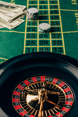 Casino table with roulette and placed chips Stock Photo