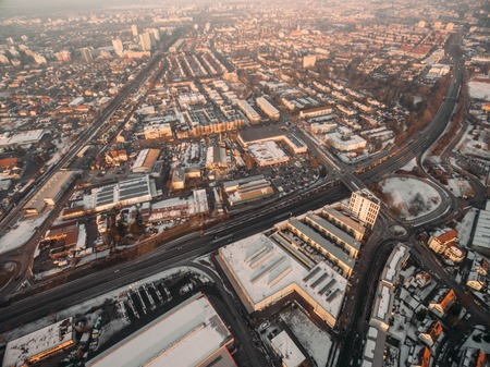 aerial view of rooftops with snow in city at winter morning, Germany