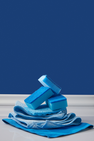 sponges and rags for spring cleaning on blue