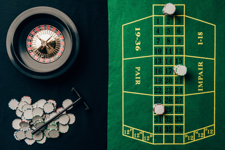 Gambling concept with chips and roulette on casino table Stock Photo