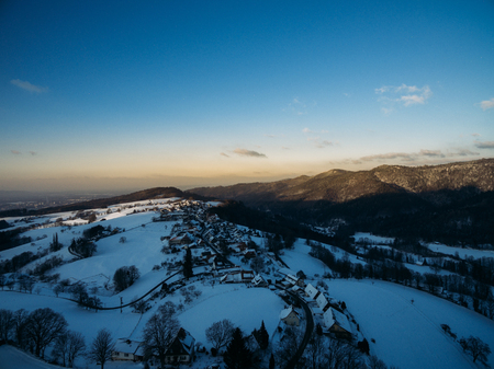 aerial view of beautiful winter landscape with hills and buildings, Germany
