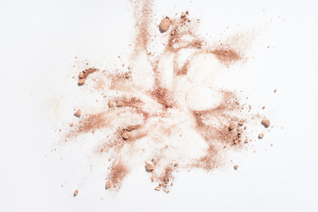 Smudges of powder foundation on white background Stock Photo
