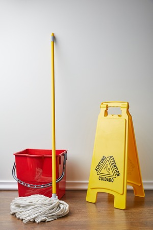 wet floor sign and bucket with mop for spring cleaning