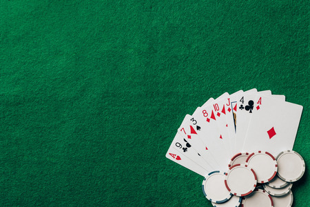 Gambling concept with cards and chips on casino table Stock Photo