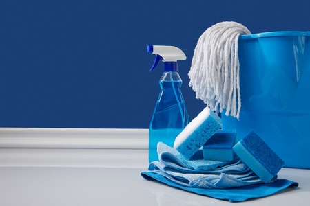 blue rags, bucket and spray for spring cleaning