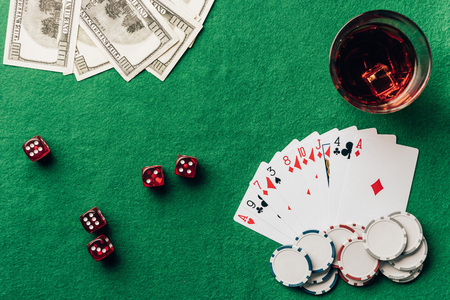 Gambling concept with with cards and dice on casino table Stock Photo
