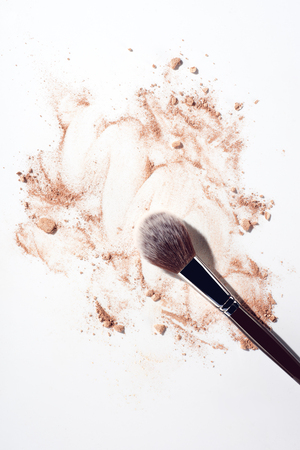 Make up powder and make up brush on white background