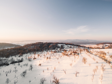 aerial view of beautiful landscape with bare trees in white snow at sunlight, Germany
