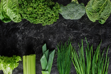 Top view of green vegetables on concrete table, healthy eating concept