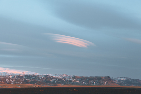 beautiful snow-covered rocky mountains and cloudy sky in iceland