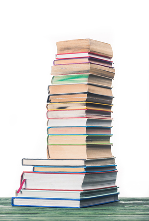 Knowledge concept with stacked books on table Banco de Imagens
