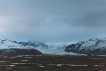 Beautiful scenic Icelandic landscape and cloudy sky