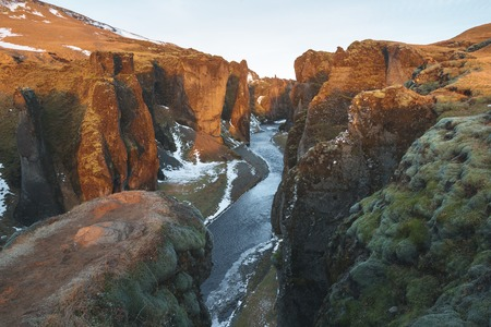 Majestic landscape with river and rocky hills, Fjadrargljufur, Iceland 免版税图像