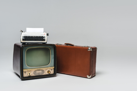 Vintage television on grey background Banco de Imagens