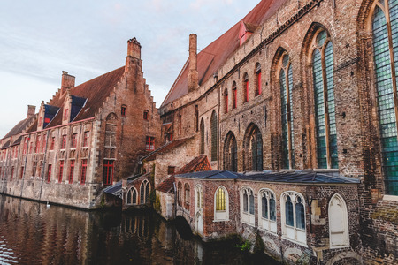 Beautiful ancient buildings and calm water of canal in Brugge, Belgium