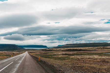 Majestic Icelandic landscape and empty asphalt road, western Iceland