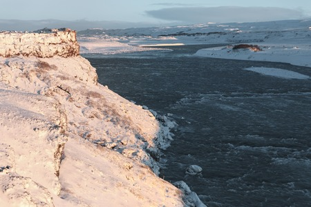Amazing view of cold river and snow-covered landscape in Iceland 写真素材