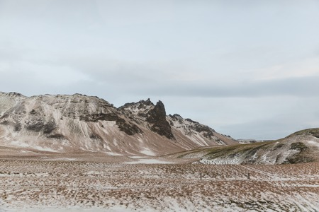 Beautiful scenic view with mountains and valley in snow, Iceland