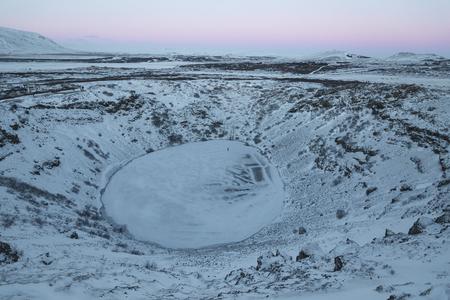 Majestic Icelandic landscape with frozen volcanic lake Kerid, Iceland