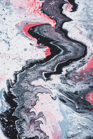 Close up of abstract texture with grey and pink acrylic paint