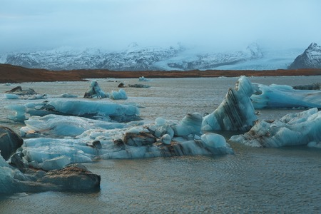 Majestic landscape with icebergs floating in water, Iceland, Jokulsarlon lagoon