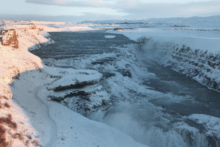 Beautiful scenic snow-covered Icelandic landscape with Gullfoss waterfall