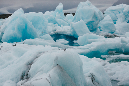 Spectacular view of white and blue icebergs in Iceland 写真素材