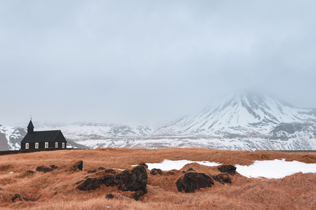 Beautiful small church and snow-covered mountains in Budir, Snaefellsnes peninsula, Iceland