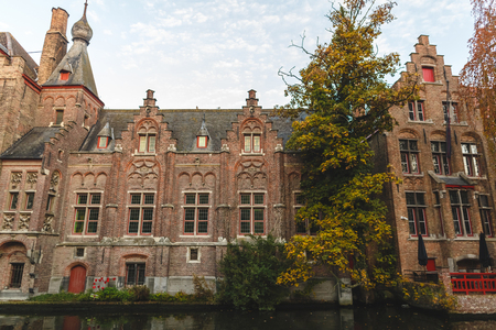 Beautiful ancient architecture reflected in canal at Brugge, Belgium