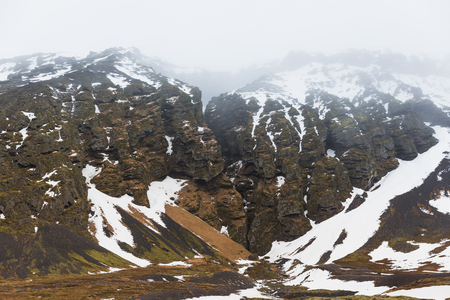 Beautiful natural scene with rocky mountains in snow, Iceland