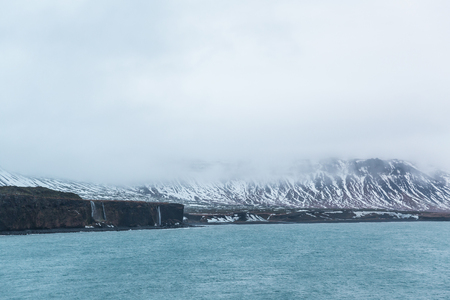 Spectacular view of beautiful fjord and snow-covered mountains, Iceland 写真素材