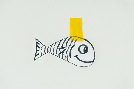 Close up view of hand drawn fish with sticky tape isolated on grey background, April fools day holiday concept