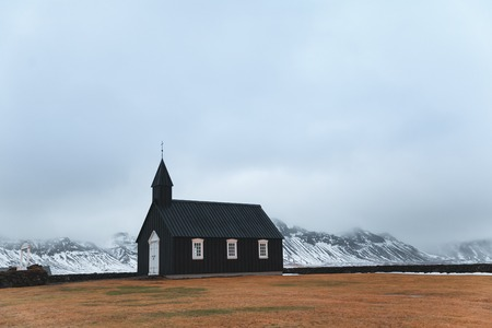 Church and beautiful snow-covered mountains in Budir, Snaefellsnes peninsula, Iceland
