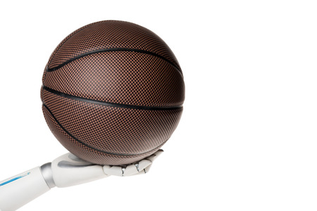 Cropped shot of robot holding basketball ball isolated on white background