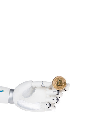 Robot hand holding golden bitcoin isolated on white background Stock Photo