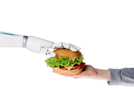 Cropped shot of robot passing tasty burger to human isolated on white background