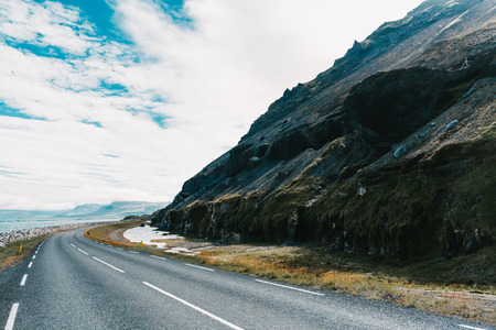 Empty asphalt road and beautiful landscape in western Iceland