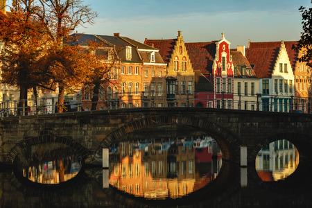 Beautiful of buildings reflected in water of canal at sunlight, Brugge, Belgium