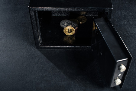 Bitcoin cryptocurrency stacked in open strongbox