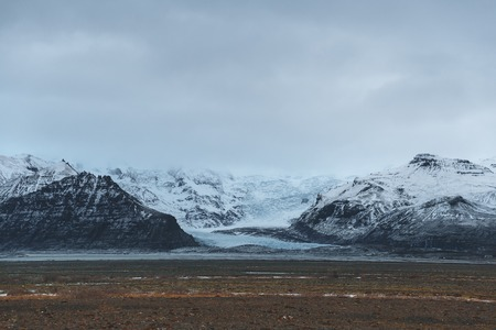 Beautiful scenic landscape with snow-covered rocky mountains, Iceland 写真素材