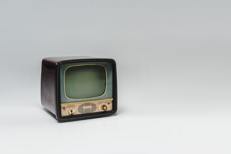 Vintage television with blank screen on grey surface background 写真素材