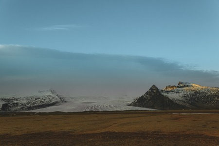 Beautiful Icelandic landscape with rocky mountains in snow