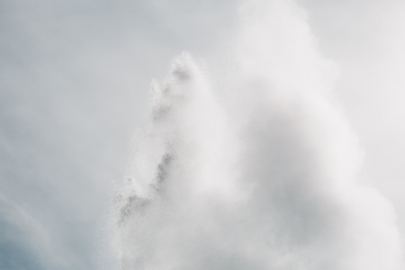 Water from powerful geyser and cloudy sky, Geysir, Iceland