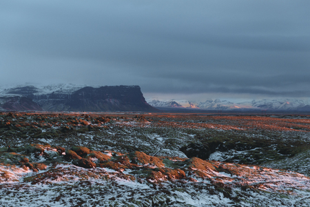 Scenic landscape with rocky mountains and valley with snow, Iceland
