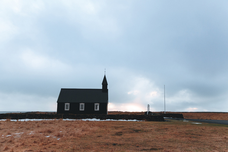 Small church and stone wall at cloudy day in Budir, Snaefellsnes peninsula, Iceland