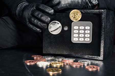 Close-up view of man opening safe with bitcoin cryptocurrency Stock Photo
