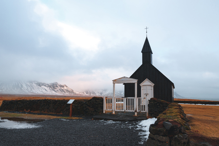 Beautiful church and white gates at cloudy day in Budir, Snaefellsnes peninsula, Iceland Stock Photo