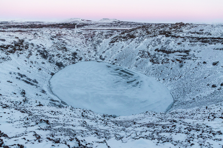Beautiful scenic landscape with frozen volcanic lake Kerid in Iceland