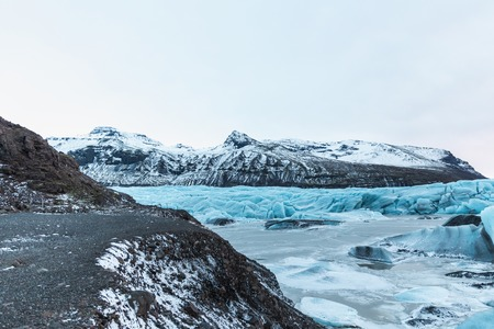 Beautiful glacial landscape with mountains and icebergs, Svinafellsjokull Glacier, Iceland