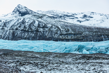Spectacular glacial landscape with mountains and Svinafellsjokull Glacier, Iceland Stock Photo